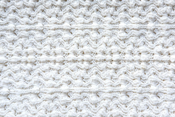 Texture knitted fabric. Figured knitting for a product. Textured cotton warm knitted fabric. Texture for designers