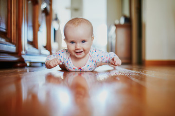 Baby girl learning to crawl