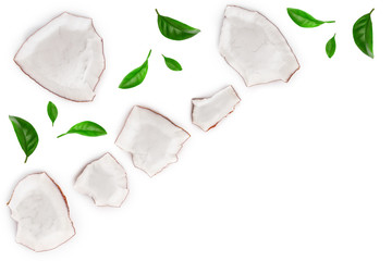 piece of coconut with leaves isolated on white background with copy space for your text. Top view. Flat lay