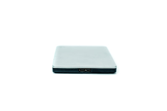 Gray portable hard drive. The concept of data storage on an external medium. Backing up files, protecting files.