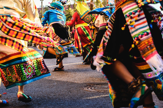 Valencia, Spain - February 16, 2019: Detail of the colorful traditional Bolivian party outfit during a carnival parade showing folklore typical of Latin countries with dancing dancers.