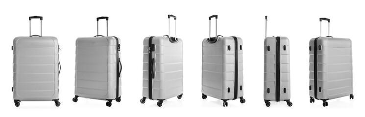 Set of stylish light suitcase for travelling on white background