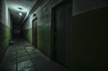 Dark corridor. Mystical interior of dark empty corridor, tunnel in an abandoned house. Dark mysterious corridor. The interior of an abandoned house, road to hell.