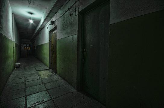 Dark corridor. Mystical interior of dark empty corridor, tunnel in an abandoned house. Dark mysterious corridor. The interior of an abandoned house, road to hell.