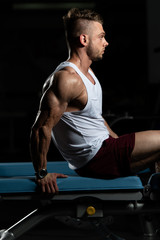 Man Resting On Bench In Fitness Center