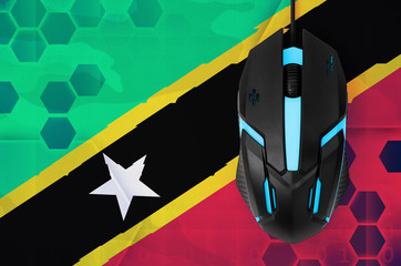 Saint Kitts and Nevis flag  and computer mouse. Concept of country representing e-sports team