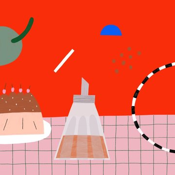 Party table with cake and sugar and abstract shapes