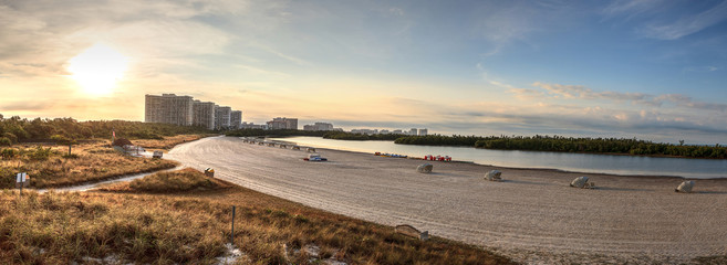 Sunrise over the highrise buildings at Tigertail Beach on Marco Island