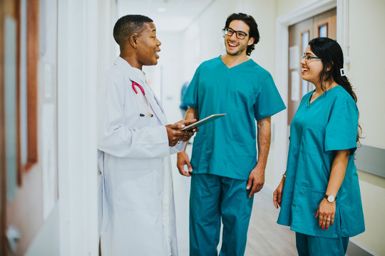 Medical team having a conversation in the hallway
