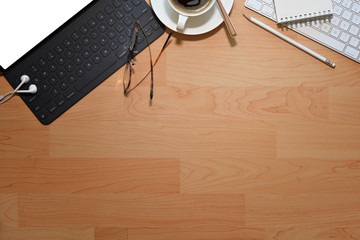 Workplace office  wooden desk with blank screen tablet and copy space