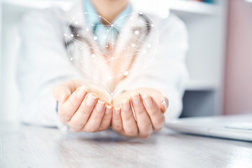 woman doctor hand heart in screen