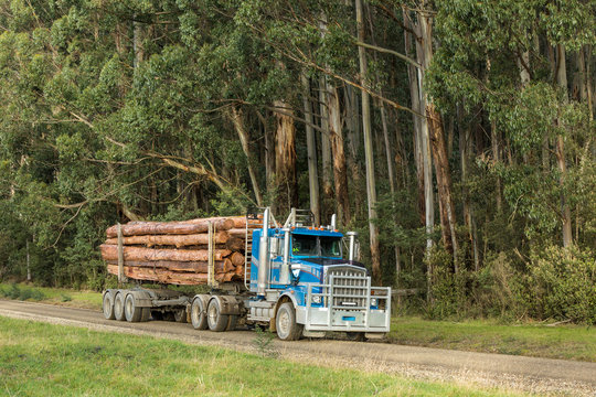 Convertible logging truck on a road in country Victoria, Australia