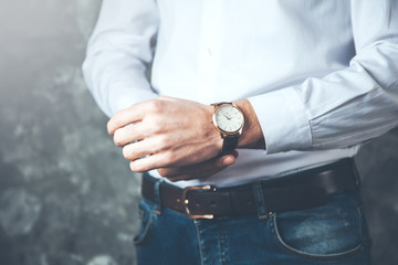 young business man hand watch