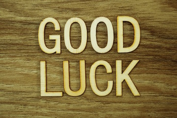 Good Luck text message on wooden background