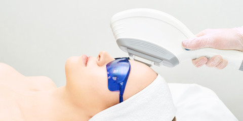 IPL laser clinic treatment. Cosmetology medical procedure. Face skin ejuvenation. Beautician device. Anti acne. Young beautiful girl. Woman facial care