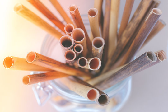 Zero waste reed drinking straws in glass jar, beautifully tinted