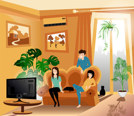 friends sit on the sofa in the living room and watch TV