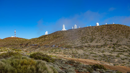 Teide Observatory and misty cloudys in the background, Tenerife, Spain