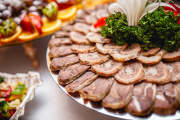 plate of meat cuts on the table