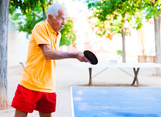 mature man playing table tennis