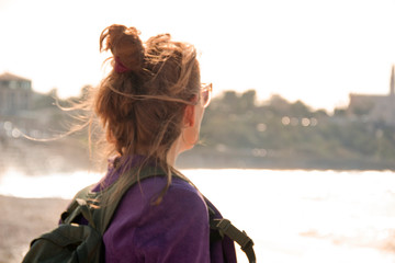 Portrait of a female traveler on the background of the city