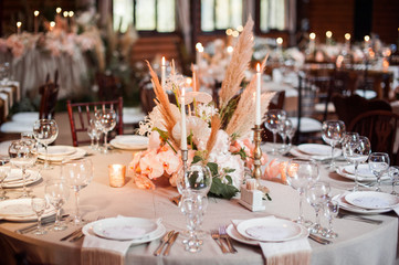 rustic wedding decorations with flowers and candles. banquet decor. picture with soft focus