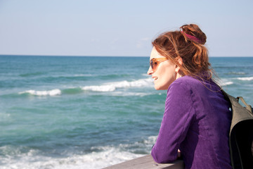 Portrait of a female tourist on a blurred sea background