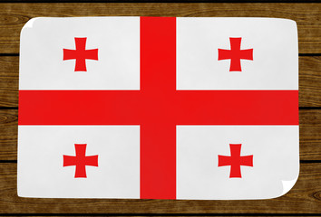 Illustration of a Georgian flag painted on the papier pasted on the woody wall