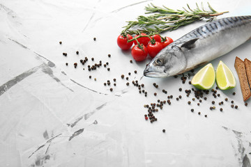 Raw mackerel fish and spices on light table
