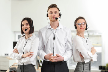 Team of technical support agents in office