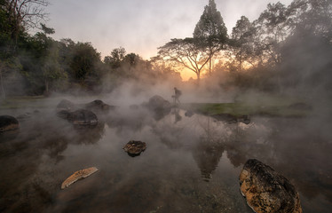Scenery of Sunrise behind hot spring at Chae Son National Park, Lampang, Thailand
