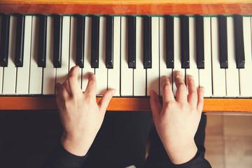 girl hand playing piano