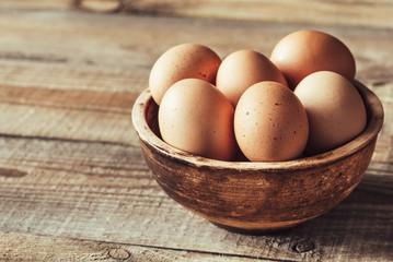 Bowl of raw chicken eggs