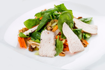 Diet salad with boiled chicken and vegetables. On white background