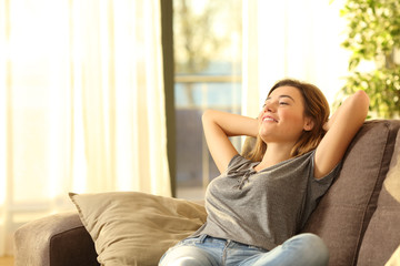 Happy woman resting comfortably at home Wall mural