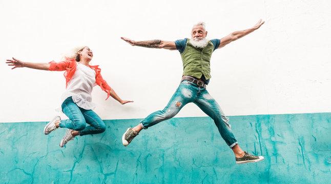 Senior crazy couple jumping outdoor