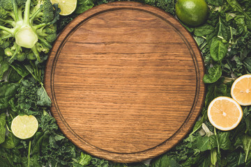 Green leaf salad and wooden cutting board. Vegan, vegetarian diet concept. Copy space for text, menu, recipe or product