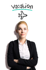 """young businesswoman looking at message """"vacation"""""""