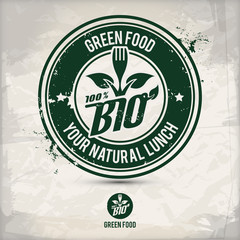 alternative green food stamp containing: two environmentally sound eco motifs in circle frames, grunge ink rubber stamp effect, textured paper background, eps10 vector illustration