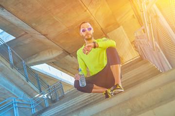 Sportsman working out / jogging on a big city urban bridge.