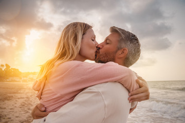 couple embracing happy on the beach