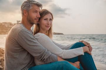 couple beach sitting watching the sunset