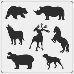 Set of animal silhouettes. Savannah, forest, farm animals. Design template for emblems, stickers and logos.