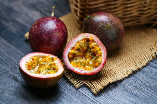 fresh passion fruit on dark wooden table