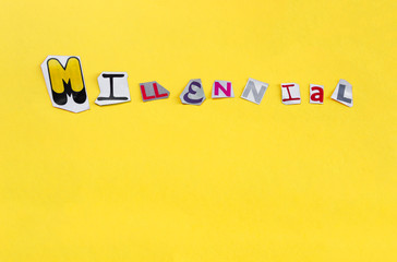 Word Millennial formed with cut out letters on yellow background. Millennial, the generation of the media and digital technologies with copy space.