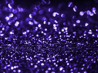 Background sequin. Violet background. Holiday abstract glitter background with blinking lights....