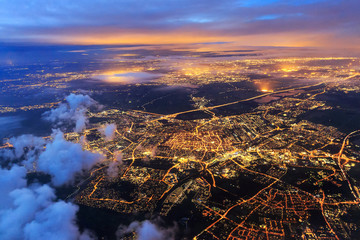 Beautiful aerial cityscape view of the city of Leiden, the Netherlands, after sunset at night in the blue hour