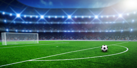 Ball on gras in soccer stadium