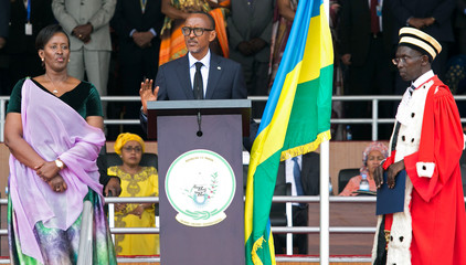 Rwanda's President-elect Paul Kagame takes the oath of office as his wife Jeannette and Rwanda's Chief Justice Sam Rugege look on during his swearing-in ceremony at Amahoro stadium in Kigali