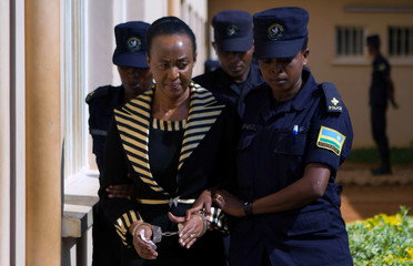 Mother of Diane Shima Rwigara is escorted by police in Kigali